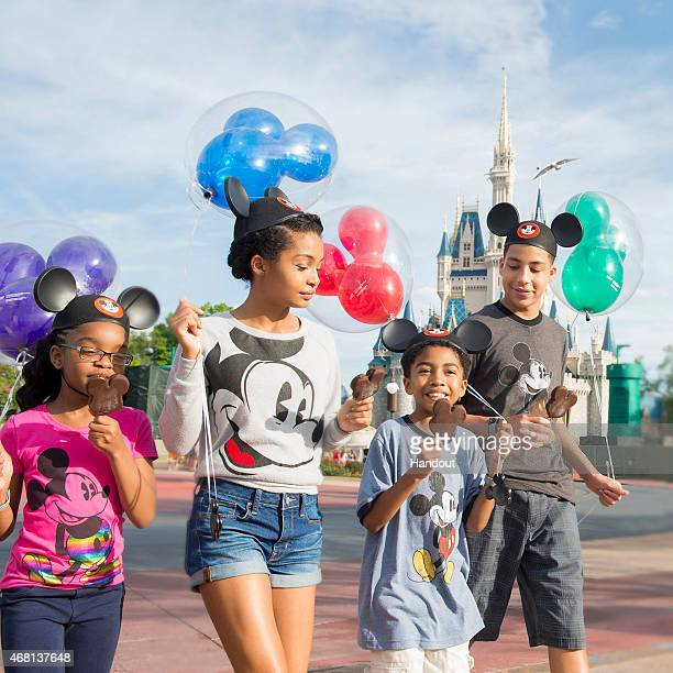 In this handout image provided by Disney Parks Actors Marsai Martin Yara Shahidi Miles Brown and Marcus Scribner from the cast of the ABC series...
