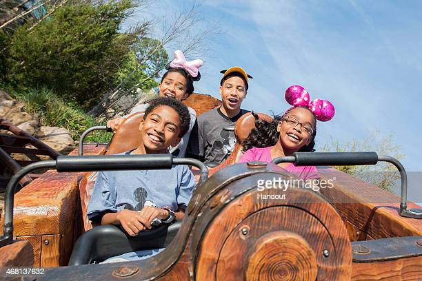 In this handout image provided by Disney Parks Actors Yara Shahidi Marcus Scribner Marsai Martin and Miles Brown from the cast of the ABC series...