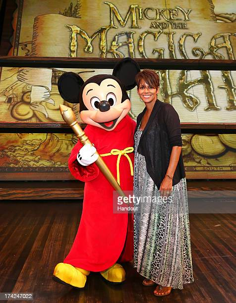 In this handout image provided by Disney Parks actress Halle Berry meets Mickey Mouse on the stage of the new live musical show 'Mickey and the...