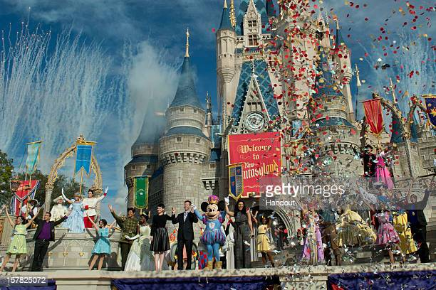 In this handout image provided by Disney Parks, fireworks and confetti fly at Cinderella Castle during the Grand Opening of New Fantasyland at Walt...
