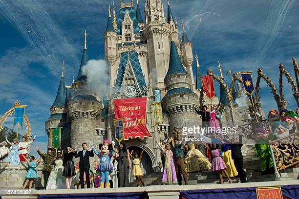 In this handout image provided by Disney Parks it was a celebratory spirit at Cinderella Castle during the Grand Opening of New Fantasyland at Walt...