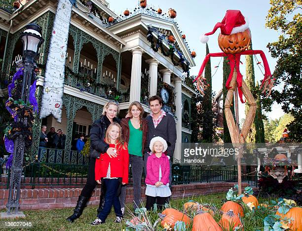 In this handout image provided by Disney Parks Jennie Garth and Peter Facinelli pose with daughters Lola Ray Luca Bella and Fiona Eve outside the...