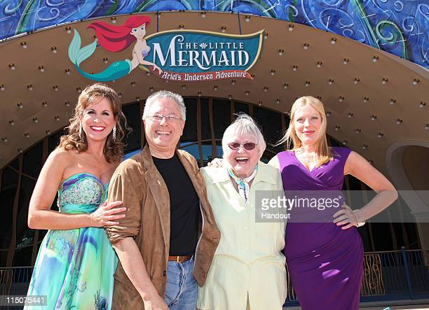 In this handout image provided by Disney Parks Jodie Benson Alan Menken Pat Carroll and Sherie Rene Scott pose for photographers following the grand...