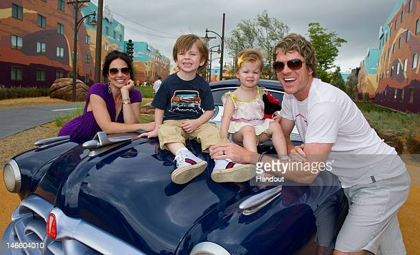In this handout image provided by Disney Parks Joe Don Rooney guitarist/vocalist of the country music trio Rascal Flatts joins his wife Tiffany son...