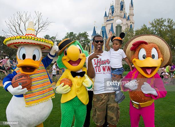 In this handout image provided by Disney Parks Los Angeles Clippers AllStar guard Chris Paul joins his son Chris at the Magic Kingdom theme park at...