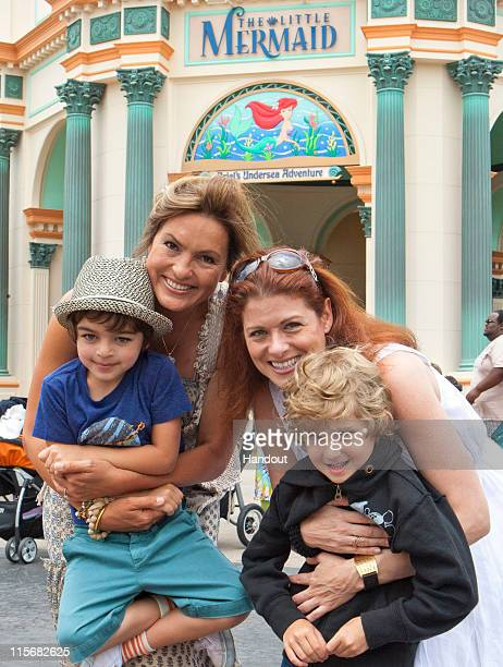 In this handout image provided by Disney Parks Mariska Hargitay and her son August join Debra Messing and her son Roman at the new attraction 'The...