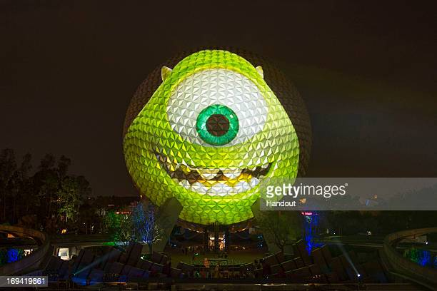 In this handout image provided by Disney Parks Mike Wazowski a character from the upcoming DisneyPixar animated film Monsters University is projected...