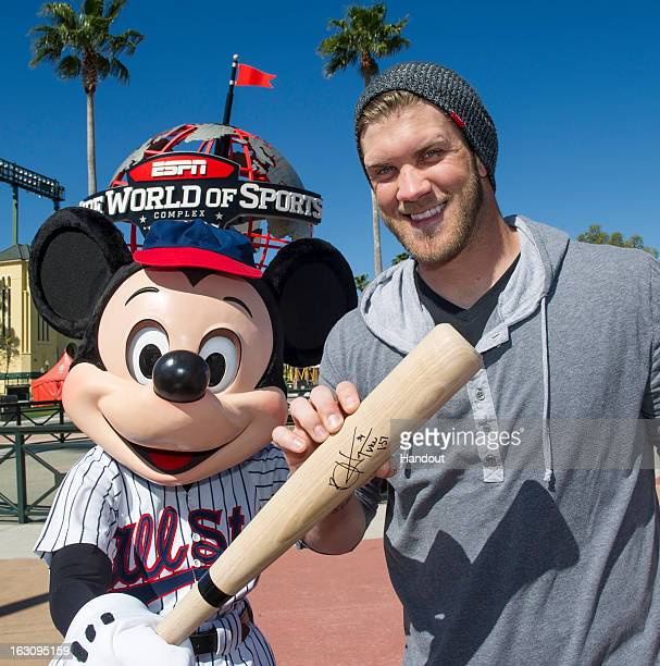 In this handout image provided by Disney Parks reigning National League Rookie of the Year Bryce Harper of the Washington Nationals poses with Mickey...