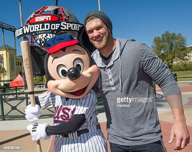 In this handout image provided by Disney Parks, reigning National League Rookie of the Year Bryce Harper of the Washington Nationals poses with...