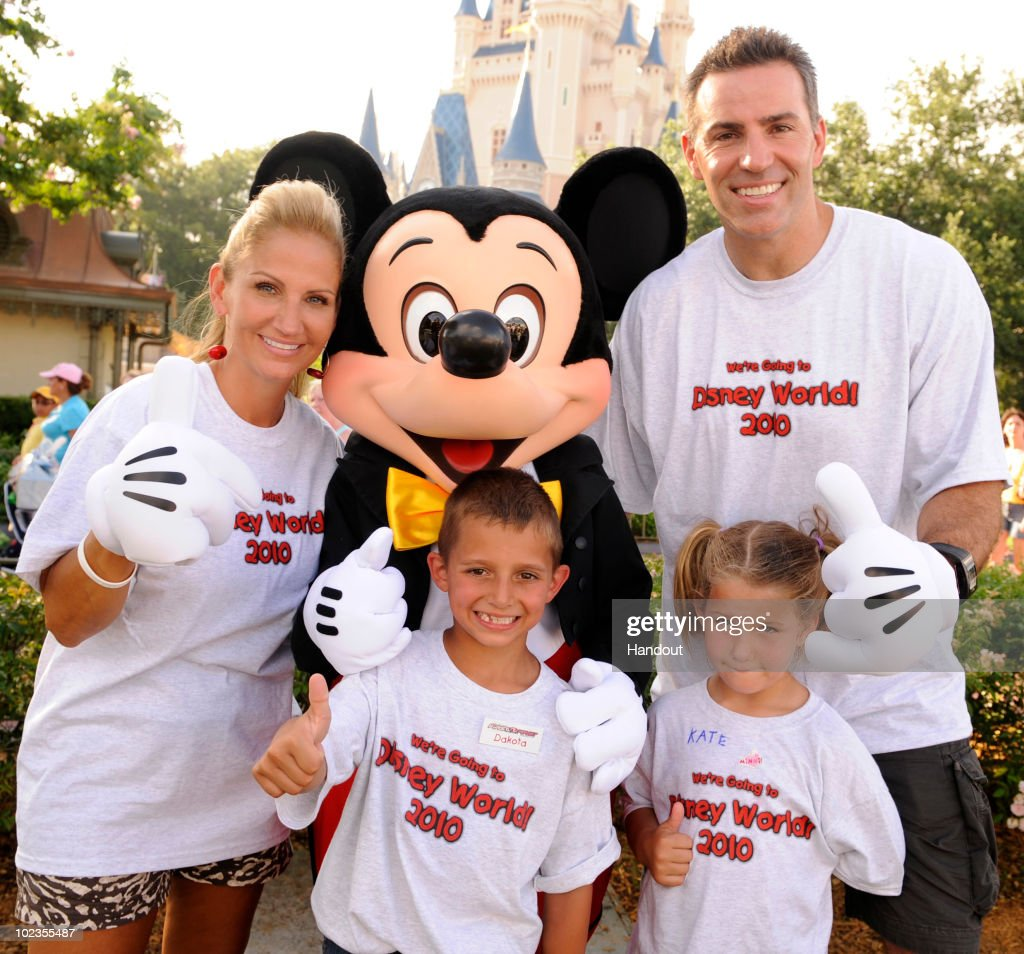 In this handout image provided by Disney, retired NFL quarterback Kurt Warner (R) poses with his wife Brenda Warner (L), Mickey Mouse and and Dakota (2nd from L) and Kate (3rd from L), two children from the 'First Things First Foundation' at the Magic Kingdom on June 23, 2010 in Lake Buena Vista, Florida. The Warners' 'First Things First Foundation,' in partnership with 'Give Kids the World' and other wish-granting organizations, hosted a group of children with life-threatening illnesses and their families on a vacation to Walt Disney World this week. This is the seventh consecutive year that the two-time NFL MVP has hosted the weeklong trip for the children and their families.
