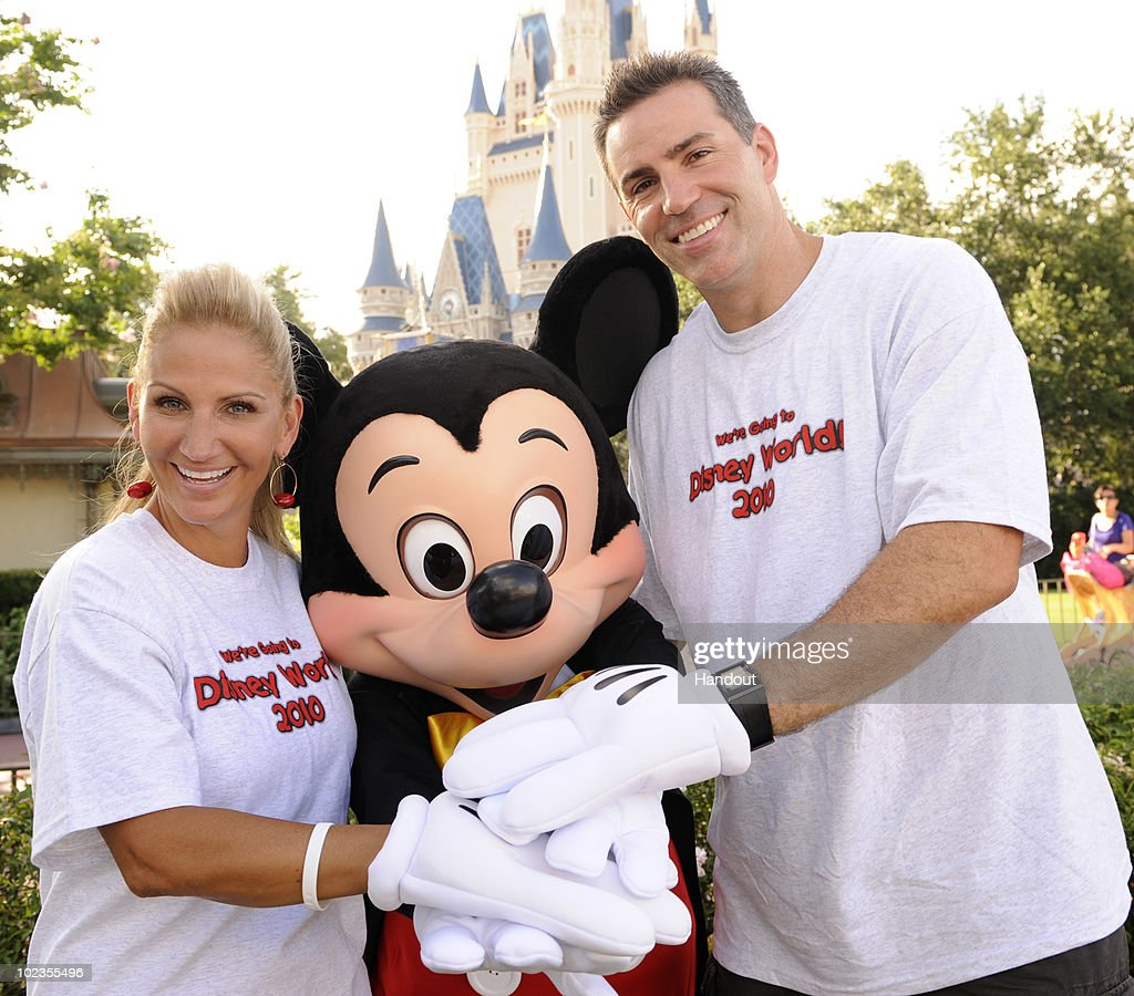 In this handout image provided by Disney, retired NFL quarterback Kurt Warner (R) poses with his wife Brenda Warner (L) and Mickey Mouse at the Magic Kingdom on June 23, 2010 in Lake Buena Vista, Florida. The Warners' 'First Things First Foundation,' in partnership with 'Give Kids the World' and other wish-granting organizations, hosted a group of children with life-threatening illnesses and their families on a vacation to Walt Disney World this week. This is the seventh consecutive year that the two-time NFL MVP has hosted the weeklong trip for the children and their families.