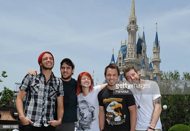 In this handout image provided by Disney Taylor York Zac Farro Hayley Williams Josh Farro and Jeremy Davis of the band Paramore pose at the Magic...