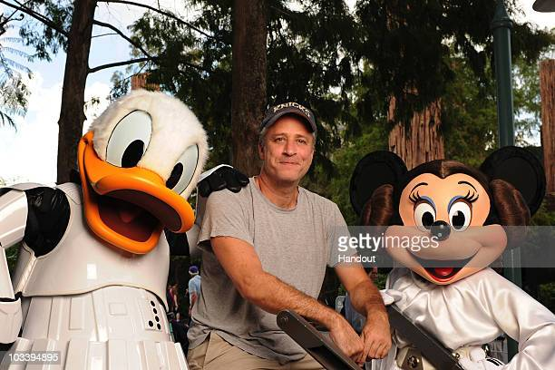 In this handout image provided by Disney The Daily Show host Jon Stewart poses Aug 14 2010 at Disney's Hollywood Studios in Lake Buena Vista Fla with...