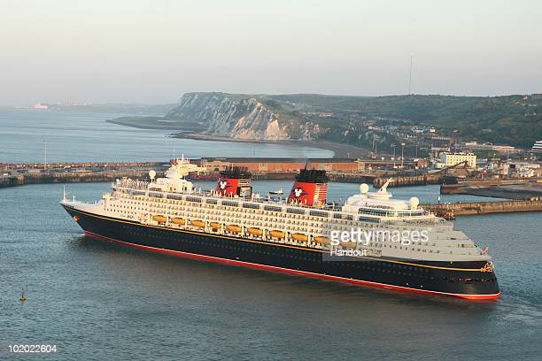 In this handout image provided by Disney the 'Disney Magic' cruise ship passes the White Cliffs of Dover in England This was the first time the ship...