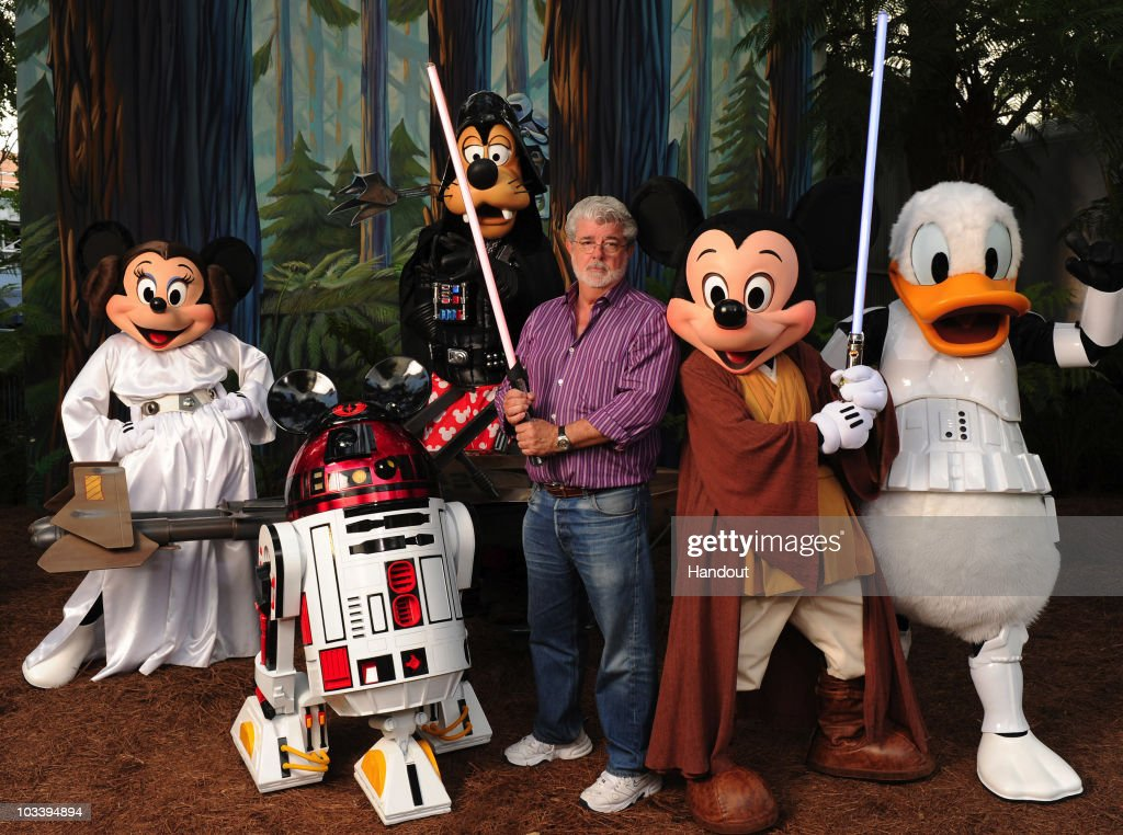 """George Lucas Poses With A Group Of """"Star Wars"""" Inspired Disney Characters At Disney's Hollywood Studios : News Photo"""
