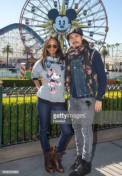 In this handout image provided by Disneyland Actress Zoe Saldana celebrates New Year's Eve with her husband Marco Perego at Disney California...