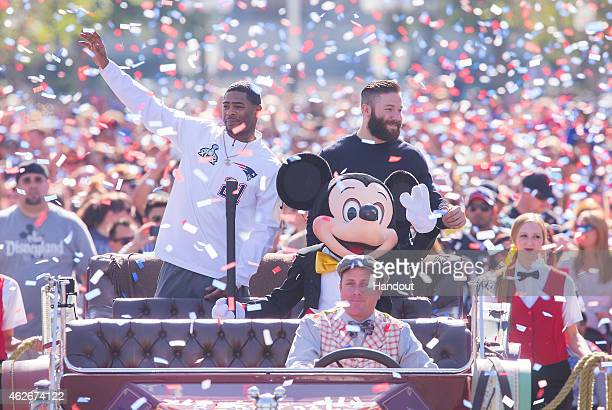 In this handout image provided by Disneyland New England Patriots players Julian Edelman and Malcolm Butler were joined by Mickey Mouse as they...