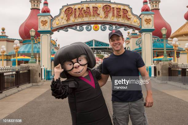 In this handout image provided by Disneyland Resort actor Matt Damon meets Edna Mode from Incredibles 2 at the new Pixar Pier in Disney California...