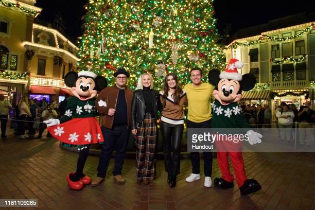 In this handout image provided by Disneyland Resort Disney's Frozen 2 voice actors Josh Gad Kristen Bell Idina Menzel and Jonathan Groff kicked off...