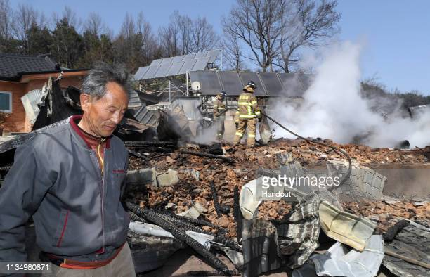 In this handout image provided by DongA Ilbo A man reacts after houses were destroyed by a wildfire on April 5 2019 in Sokcho South Korea South Korea...