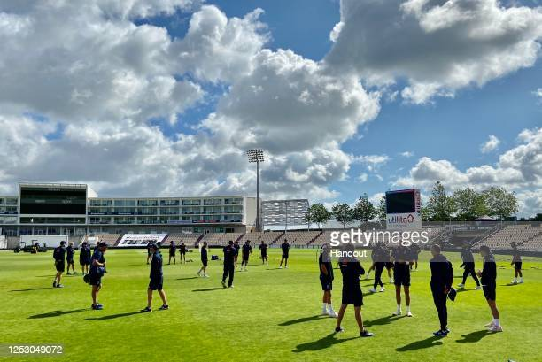 In this handout image provided by ECB Englnd players warms up before a behind closed training doors session at The Ageas Bowl on June 28, 2020 in...