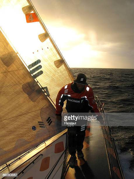 In this handout image provided by Ericsson Racing Team Ryan Godfrey walks on the bow of Ericsson 4 during the 6th leg of the Volvo Ocean Race between...