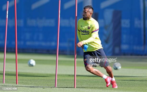 In this handout image provided by FC Barcelona, Arturo Vidal of FC Barcelona runs during a training session at Ciutat Esportiva Joan Gamper on May...