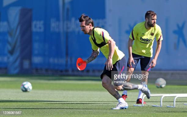 In this handout image provided by FC Barcelona, Lionel Messi of FC Barcelona runs during a training session at Ciutat Esportiva Joan Gamper on May...
