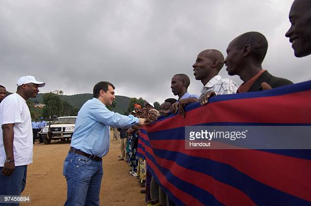 In this handout image provided by FC Barcelona President of FC Barcleona Joan Laporta is greeted by wellwishers on his arrival at the UNHCR Kibiza...