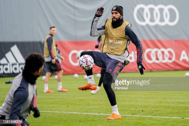 In this handout image provided by FC Bayern Muenchen battles Eric Maxim ChoupoMoting for the ball during a training session at Bayern's training...