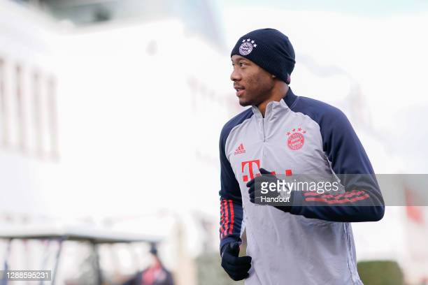 In this handout image provided by FC Bayern Muenchen David Alaba of FC Bayern Muenchen arrives for a training session a day before the UEFA Champions...