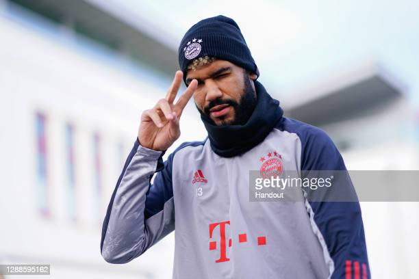 In this handout image provided by FC Bayern Muenchen Eric Maxim ChoupoMoting of FC Bayern Muenchen arrives for a training session a day before the...