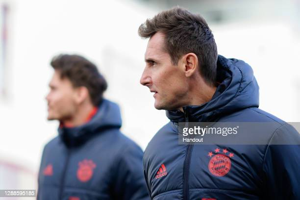 In this handout image provided by FC Bayern Muenchen Miroslav Klose, assistant coach of Bayern Muenchen, arrives for a training session a day before...