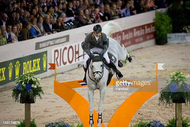 In this handout image provided by FEI Marco Kutscher of Germany riding Cornet Obolensky competes at the Rolex FEI World Cup Jumping Final 2012 on...