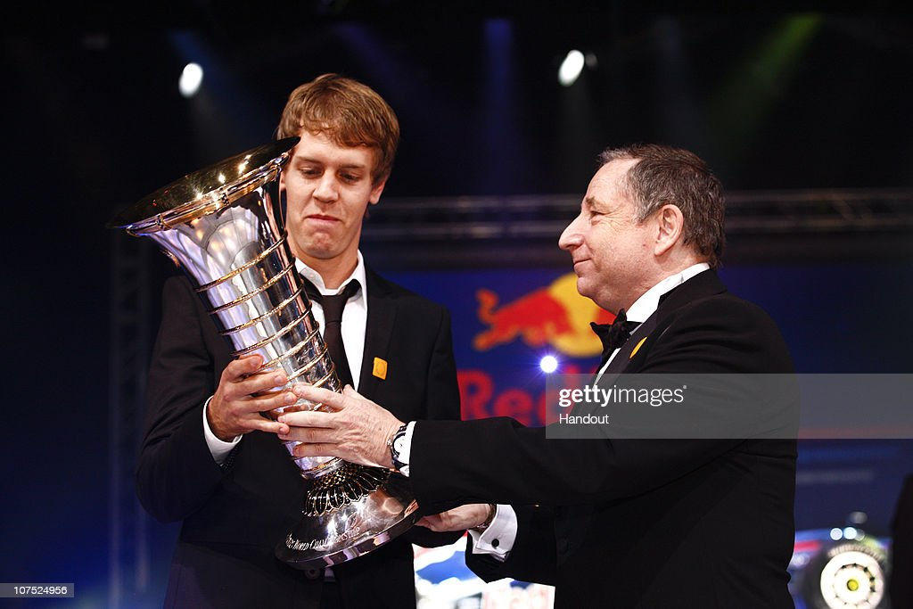 In this handout image provided by FIA (Federation Internationale de l'Automobile), FIA President Jean Todt presents Formula One World Champion Sebastian Vettel with the Drivers' trophy during the 2010 FIA Gala Prize Giving Ceremony on December 10, 2010 in Monaco.