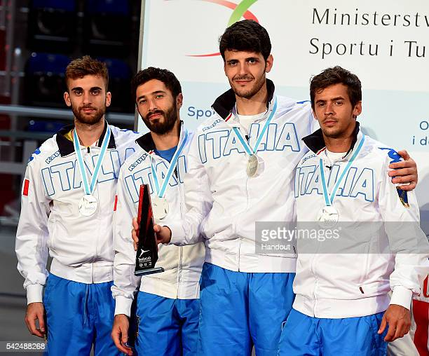 In this handout image provided by FIE Giorgio Avola Andrea Baldini Andrea Cassara and Daniele Garozzo of Italy celebrate during the ceremony of men's...