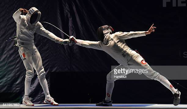 In this handout image provided by FIE JeanMichel Lucenay of France and Max Heinzer of Switzerland compete during the semifinal of the men's epee...