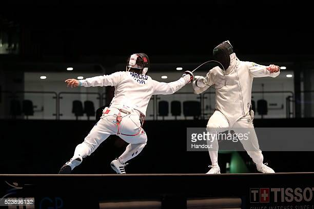 In this handout image provided by FIE Korea's Kyoungdoo Park scores a touch on Ukraine's Bogdan Nikishin at the Rio de Janeiro men's epee grand prix...
