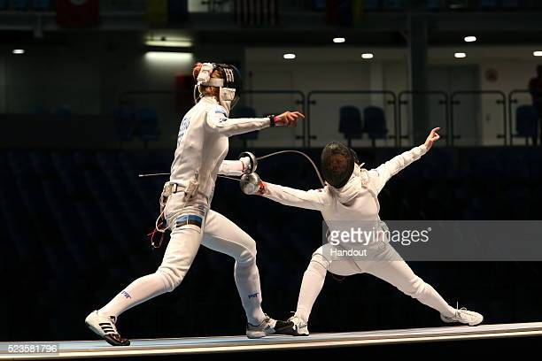 In this handout image provided by FIE Russian epee Olympic champion Tatiana Logunova is scored on by Estonia's Katrina Lehis in the semifinal of the...