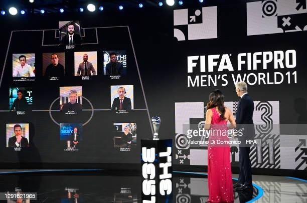 In this handout image provided by FIFA, Arsene Wenger and Reshmin Chowdhury present the FIFA FIFAPRO Men's World 11 during the The Best FIFA Football...