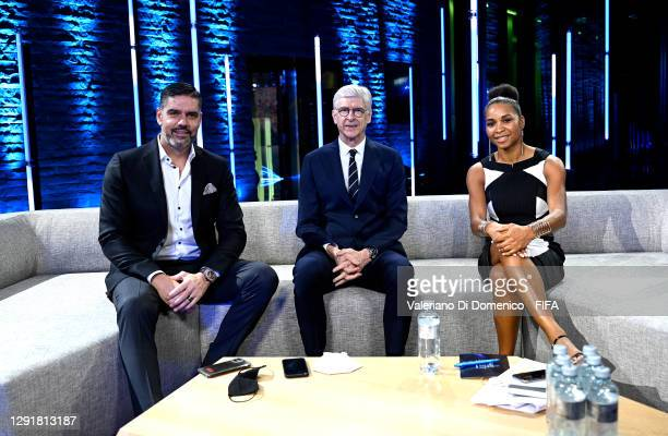 In this handout image provided by FIFA, Pascal Zuberbuehler, Arsene Wenger and Laura Georges pose for a photo prior to the The Best FIFA Football...