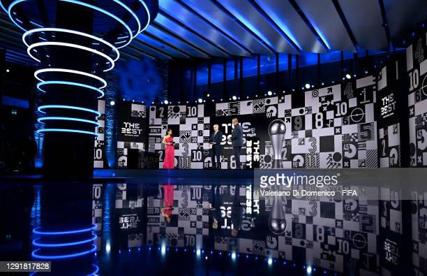 In this handout image provided by FIFA, Reshmin Chowdhury and Ruud Gullit interview Arsene Wenger on stage during the The Best FIFA Football Awards...
