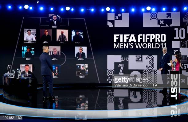 In this handout image provided by FIFA, Ruud Gullit, Arsene Wenger and Reshmin Chowdhury present the FIFA FIFAPRO Men's World 11 during the The Best...