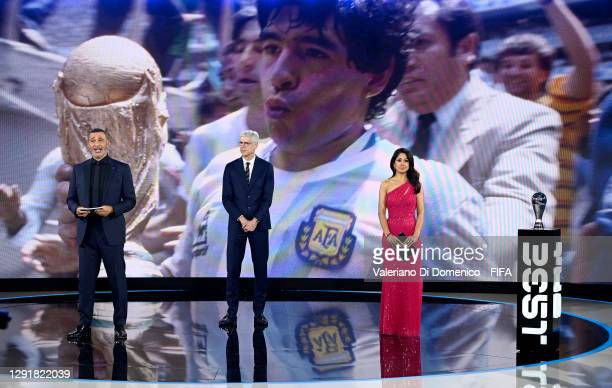 In this handout image provided by FIFA, Ruud Gullit, Arsene Wenger and Reshmin Chowdhury pay tribute to Diego Maradona during the The Best FIFA...