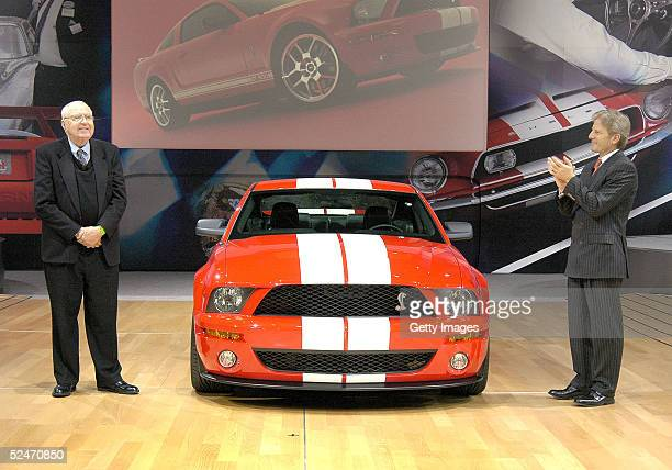 In this handout image provided by Ford Motor Company Ford Motor Company Group Vice President for Product Creation Phil Martens applauds Carroll...