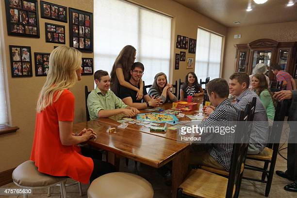 """In this handout image provided by FOX News Channel, FOX News Channel's Megyn Kelly sits down with the Duggar children of the TLC program """"19 Kids and..."""