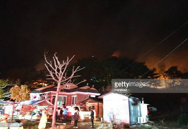 In this handout image provided by Gangwon Province a fire burns through a forest on May 01 2020 in Goseonggun South Korea A fire broke out late...