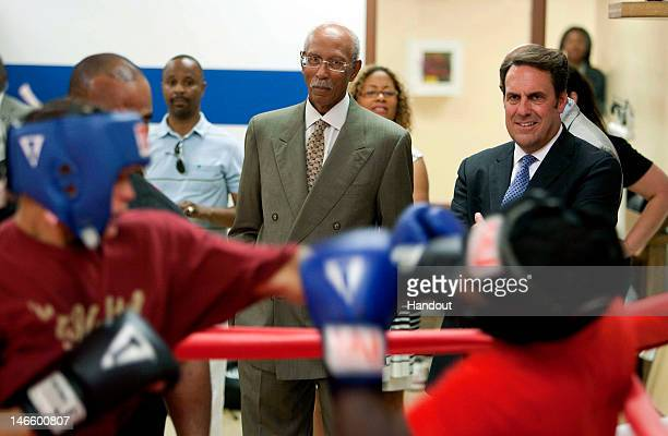 In this handout image provided by General Motors Detroit Mayor Dave Bing and General Motors President North America Mark Reuss watch a boxing...