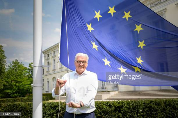 In this handout image provided by German Government Press Office , Federal President Frank-Walter Steinmeier hoists a European flag in the garden of...
