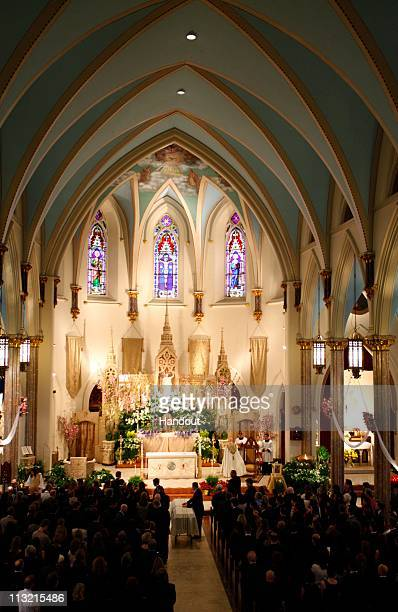 In this handout image provided by Getty Images A memorial service for Getty Images photographer Chris Hondros takes place at Sacred Hearts of Jesus...